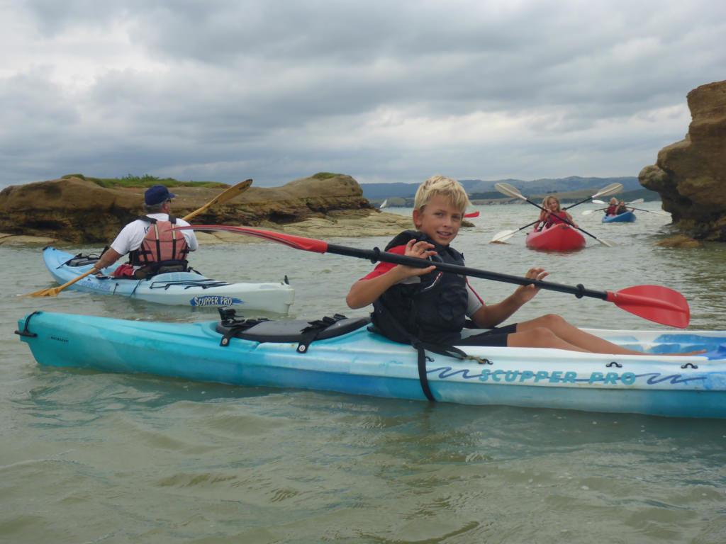 A Rocha's 'Karioi Kids' exploring a bay at Raglan, New Zealand, at high tide.