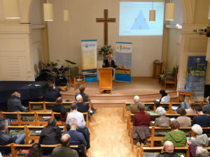 Dave speaking at St Michael's Church during COP21