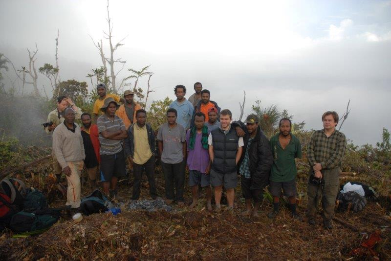 Dr Martin Kaonga (front left) with the rest of the Nakanai team at the top camp helipad site, cleared in a forest which is far from the nearest road. (© Stephen Richards / Conservation International)