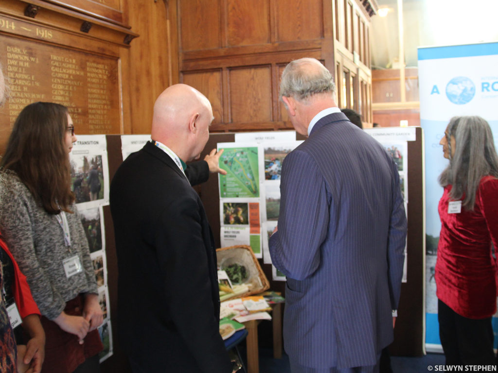 Dave showing HRH a map of Wolf Fields (Photos: Selwyn Stephen)